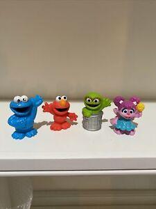 2013 Sesame Street Workshop Plastic Figures Elmo, Oscar, Cookie Monster & Abby