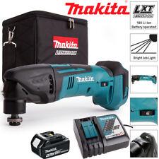 Makita DTM50Z 18 V Oscilante Multiherramienta Con 1 X 4.0Ah BL1840, DC18RC Y Bolsa De Cubo