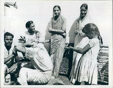 1968 Girl Squirts Water on Guest Holi Celebration Agra India Press Photo
