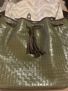DOONEY & BOURKE ARMY GREEN WITH BROWN LEATHER ADJUSTABLE STRAP DUFFLE PURSE