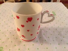 Lefton cup with heart shaped handle and hearts on it #03092