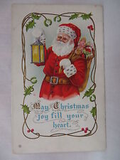 VINTAGE EMBOSSED CHRISTMAS POSTCARD SANTA CLAUS WITH A LANTERN & TOYS UNMAILED