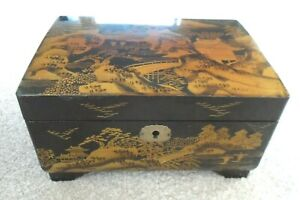 Vintage Japanese musical jewellery box, black and gold lacquered finish.