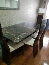 marble dining table with 6 high back chairs in cream & brown.