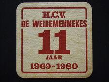 SKOL MET GOUD BEKROOND H.C.V. DE WEIDEMENNEKES 11 JAAR 1969-1980 COASTER