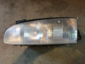 93 94 95 96 97 1993-1997 GEO PRISM DRIVER HEADLIGHT LEFT HEAD LIGHT
