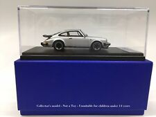 1:43 LOOKSMART LS203A PORSCHE 911 3.2 COUPE' 1989 WITH REAR WING SILVER