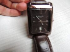 Gents Kenneth Cole Brown Rectangular watch, battery reqd
