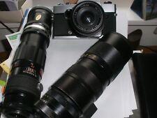 Spiegelreflexkamera Revueflex T mit  1 Weitwinkel- und 2 Teleobjektiven