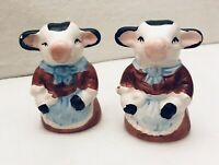 Black And White Cow Salt And Pepper Shakers With Blue Apron