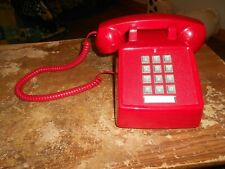 vintage cortelco red push button telephone
