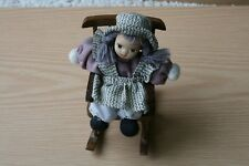Vintage Doll In Wooden Rocking Chair