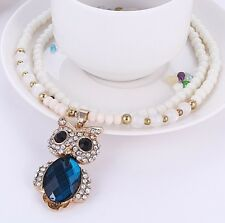 WHITE STONE BEADS WITH GOLD TONE BLUE FACETED & DIAMANTE CRYSTAL OWL NECKLACE