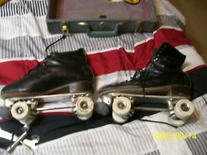 pair of sure grip  roller skates with reidall boots size 10 and a half double E