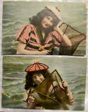 Pair c1906 Pretty Girl at beach with fishing net glitter postcards
