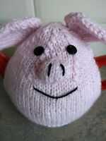 Hand-knitted Percy Pig tea cosy. Fits medium teapot.