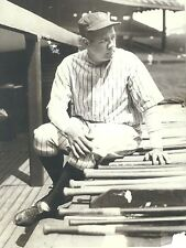 THE GREAT NEW YORK YANKEES BABE RUTH SITTING ON DUGOUT STEPS WITH BASEBALL BATS