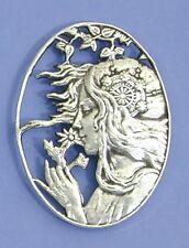 Art Nouveau style brooch design of a summer breeze