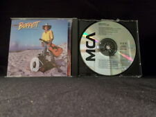 Jimmy Buffett. Riddles In The Sand. Compact Disc. 1984. Made In The U.S. (?)