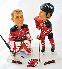 Devils (Scott Stevens #4 and Martin Brodeur #30)duel Ice base action bobble