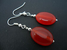A PAIR OF SIMPLE RED JADE SILVER PLATED DROP EARRINGS. NEW.