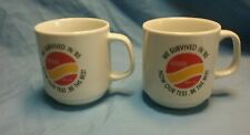 "Set of 2 Conoco oil coffee cups ""We survived in 85 now our test, be the best"""