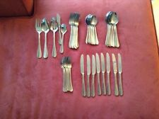 International simplicity stainless 8 complete place settings with serving pieces