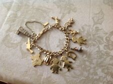 Vintage Monet Gold Toned Ladies Bracelet With 12 Charms