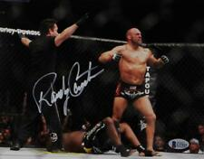 Randy Couture Signed UFC 8x10 Photo With Belt- Beckett Auth *Ref Facing Couture