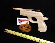 Rubber band toy pistol.