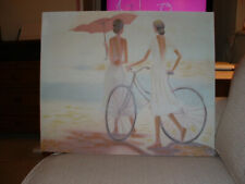 Picture on large canvas of two elegant girls and a bicycle in creams and browns