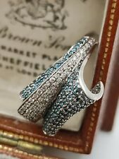 9ct White Gold Fancy White And Blue Diamond Modernist Crossover Ring