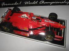 1:18 Ferrari F310B M. Schumacher 1997 rebuilt Full tabacco in showcase