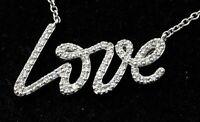"Tiffany & Co. Paloma Picasso 18K WG .50CTW VS1/F diamond ""Love"" pendant necklace"
