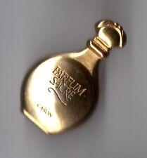 Pin's parfum / bouteille de parfum sacré de Caron (signé Aubert Paris)