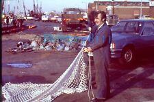 More details for  35mm slide grimsby fishermen on quayside tending nets 1980's
