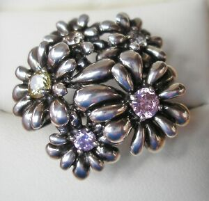 Pretty new Sterling Silver ring by QVC 5 gem set flowers size O