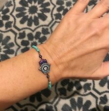 TINY TURQUOISE, PYRITE AND CRYSTAL COVERED EVIL EYE HAND BRACELET