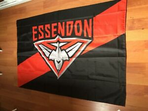 AFL   ESSENDON BOMBERS ORIGINAL WEARING CAPE FLAG 150 X 100 CM BRAND NEW