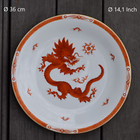 A red ming dragon charger from Meissen porcelain factory