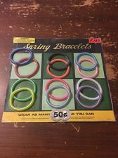 Vintage Vending Machine Toy Display Spring Bracelets Wrist Glitter 1986 Game