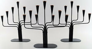 3 large seven armed Swedish design candlesticks in metal with brass top