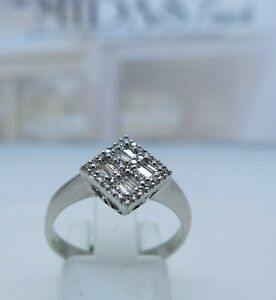 18 carat  white diamonds brilliant and emerald cut cluster ring ,
