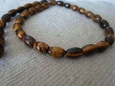 Strand Of Tigers Eye Rice Beads