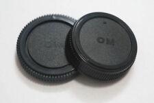 Tapas para objetivos para cámaras Olympus