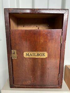 An unusual handmade wooden post box / mail box
