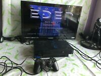 Sony PlayStation 2 Black Console & 4 games with official controller - PS2