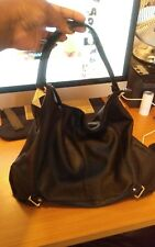 Woman's Black Bag With Gold Hardware