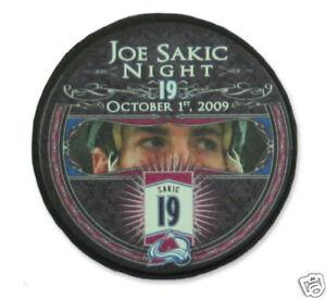 JOE SAKIC AVALANCHE RETIREMENT NIGHT SOUVENIR PUCK 10/1