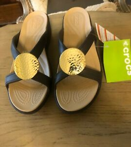 NWT Crocs Womens Brown with Gold Medallion size 10